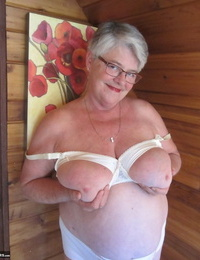 Nasty nan with brief grey hair bares her big hooters and butt with a striptease