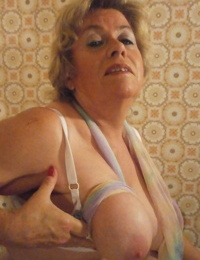Old girl Caro showcases her huge inborn hooters in white pantyhose