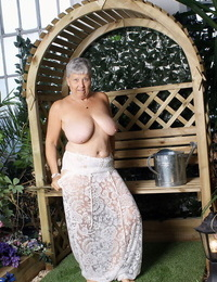 Hot granny Savana uncorks her giant breasts while attending to garden