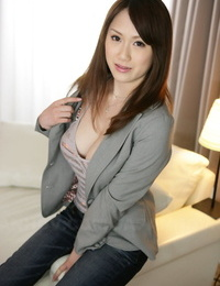 Japanese solo model Yui Takashiro cracks a smile while posing non naked