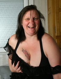 Obese older lady Katty A whips out her hefty knockers prior to dildoing herself