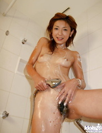 Slim asian stunner stripping off her clothes and taking a shower
