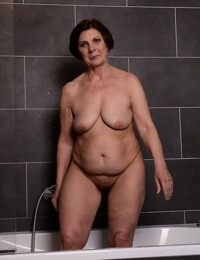 Fat short haired granny Margo T strips- showers & teases with her big naturals