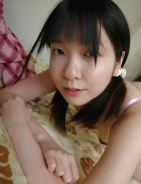 Timid asian teenage unclothing down and showcasing her fuckbox in close up